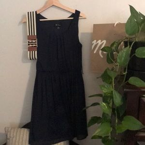 Navy midi dress with blue and white striped belt.